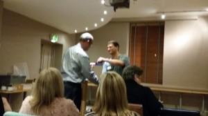 Sean Gordon receiving Best Speaker ribbon