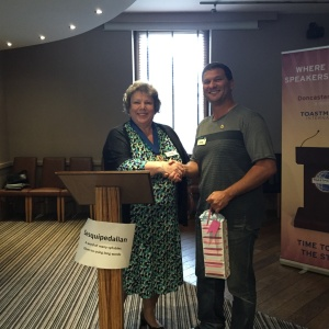 Jean Stewart presents Andrew Miller with a gift