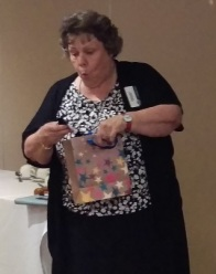 Outgoing President Jean Stewart opens gift from Club for her successful year in office
